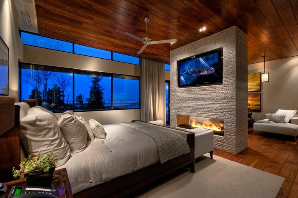 Wall-Mounted-TV-and-Fireplace-Design-in-Modern-Wooden-Bedroom
