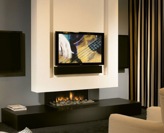 Flat Screen TVs above Fireplaces Sandra Espinet