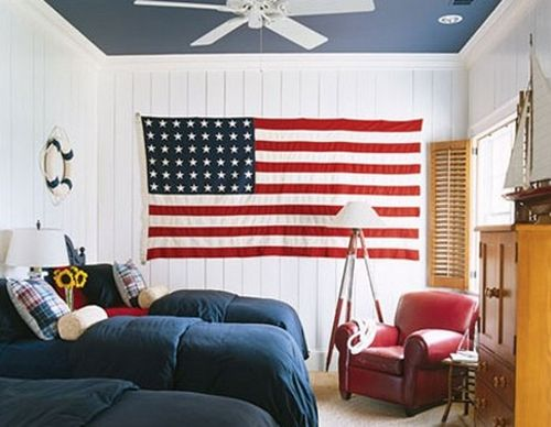 American-flag-in-the-wall-red-sofa-dark-bed-cover-in-cozy-kids-room-915x710